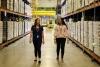 UArizona nutritional science students walk the warehouse floor at the Community Food Bank