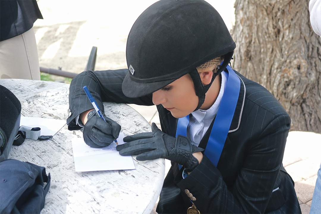 At the end of the show, competitors wrote thank you cards to our sponsors for supporting such a fantastic sport. Rider Emma Koprowski is pictured writing a thank you card after winning first place.